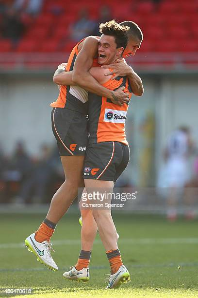 Zac Williams of the Giants celebrates scoring a goal during the round 15 AFL match between the Greater Western Sydney Giants and the St Kilda Saints...