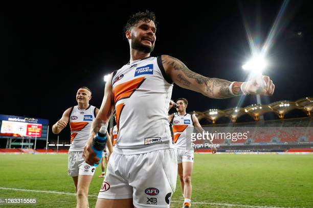 Zac Williams of the Giants celebrates winning the round nine AFL match between Gold Coast Suns and the Greater Western Sydney Giants at Metricon...