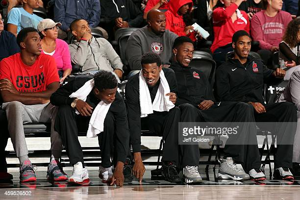 Zacarry Douglas Micheal Warren Jerron Wilbut Tavrion Dawson and Jibreel Faulkner of the CSUN Matadors sit on the bench as they eye the play against...