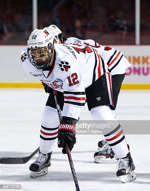 """Zach Aston-Reese of the Northeastern Huskies skates against the New Hampshire Wildcats during NCAA hockey at Fenway Park during """"Frozen Fenway"""" on..."""