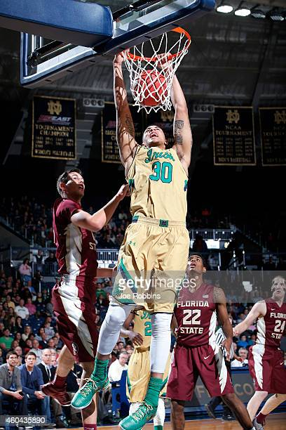 Zach Auguste of the Notre Dame Fighting Irish goes up for a dunk against the Florida State Seminoles during the game at Purcell Pavilion on December...
