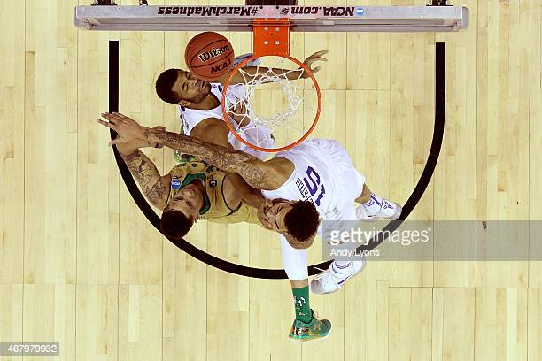 Zach Auguste of the Notre Dame Fighting Irish goes up for the ball against Andrew Harrison and Willie CauleyStein of the Kentucky Wildcats during the...
