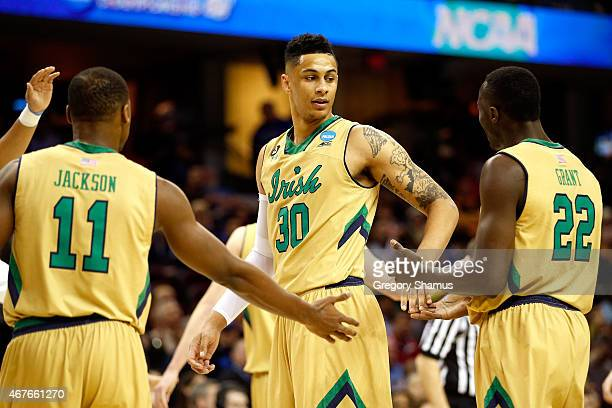 Zach Auguste of the Notre Dame Fighting Irish reacts with Demetrius Jackson and Jerian Grant after a play in the first half against the Wichita State...