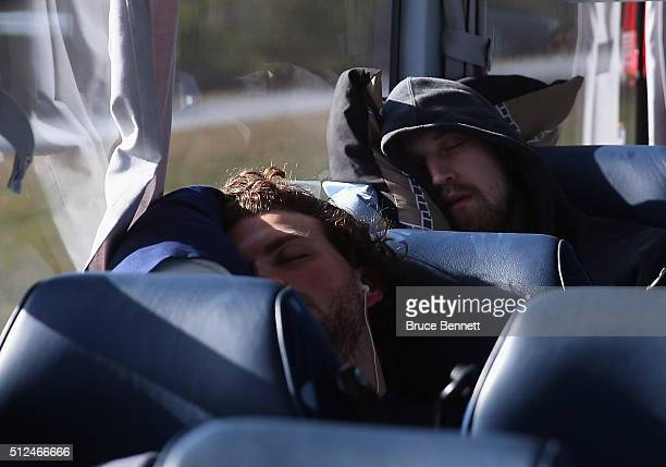 Zach Bell and Spencer McAvoy of Orlando Solar Bears catch some sleep on the bus trip to play against the Florida Everblades at the Germain Arena on...