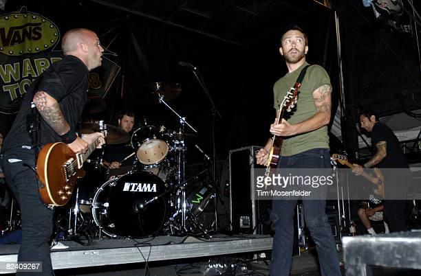 9f7efc43bb92c9 Zach Blair Brandon Barnes Tim McIlrath and Joe Principe of Rise Against  perform as part of