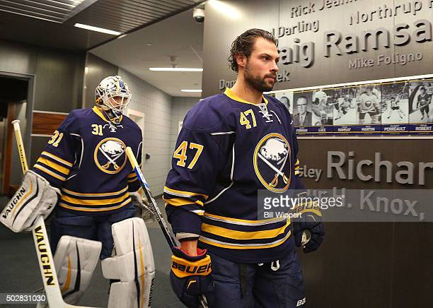 Zach Bogosian and Chad Johnson of the Buffalo Sabres head to the ice to play the New Jersey Devils in an NHL game on December 15 2015 at the First...