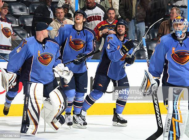 Zach Bogosian of the Atlanta Thrashers celebrates with Nik Antropov after scoring a goal in overtime against the Nashville Predators at Philips Arena...