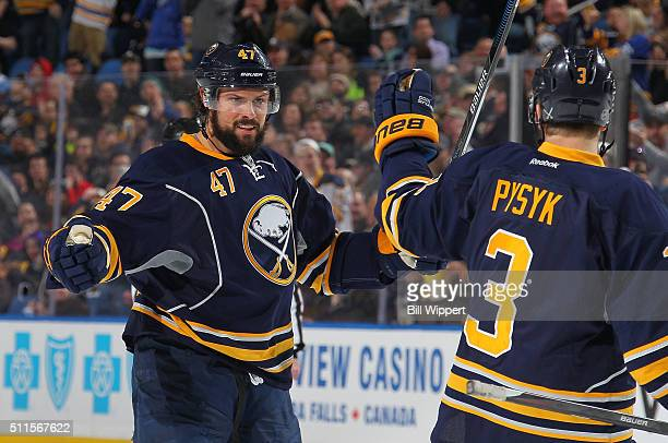 Zach Bogosian of the Buffalo Sabres celebrates his first period goal against the Pittsburgh Penguins with teammate Mark Pysyk during an NHL game on...