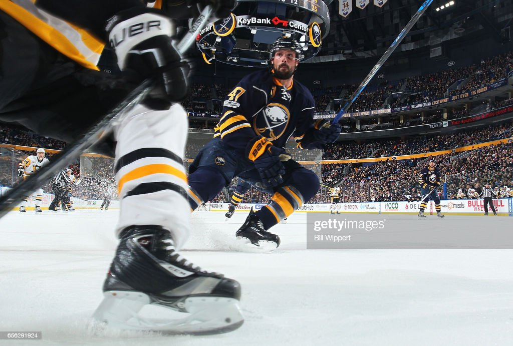 Zach Bogosian #47 of the Buffalo Sabres defends aganst the Pittsburgh Penguins during an NHL game at the KeyBank Center on March 21, 2017 in Buffalo, New York.