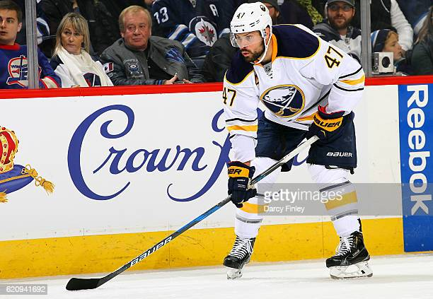 Zach Bogosian of the Buffalo Sabres gets set for a first period faceoff against the Winnipeg Jets at the MTS Centre on October 30 2016 in Winnipeg...