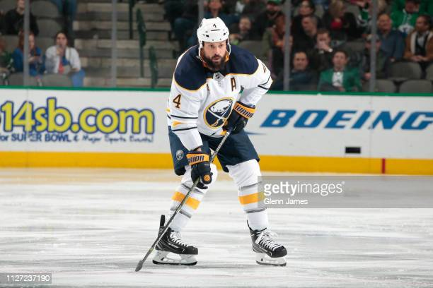 Zach Bogosian of the Buffalo Sabres handles the puck against the Dallas Stars at the American Airlines Center on January 30 2019 in Dallas Texas