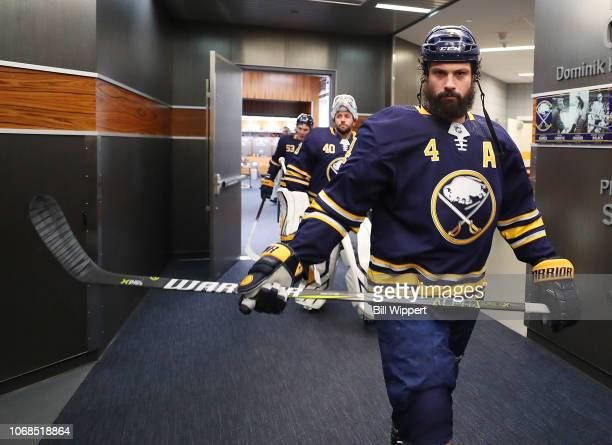 Zach Bogosian of the Buffalo Sabres heads to the ice for warmups prior to an NHL game against the Toronto Maple Leafs on December 4 2018 at KeyBank...