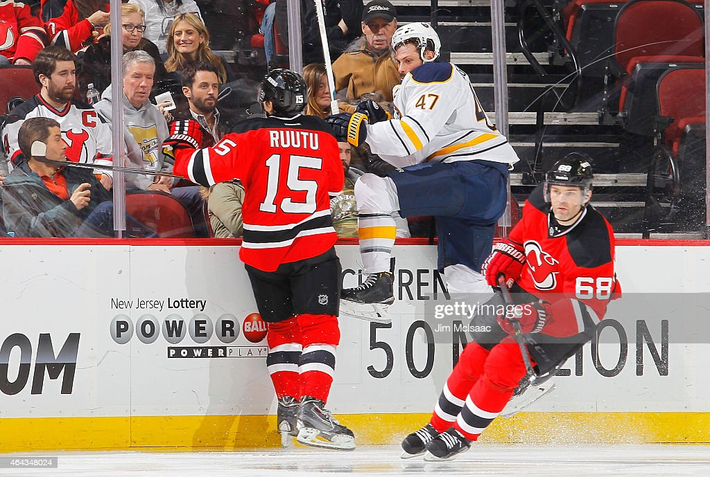 Zach Bogosian #47 of the Buffalo Sabres in action against Tuomo Ruutu #15 of the New Jersey Devils at the Prudential Center on February 17, 2015 in Newark, New Jersey. The Devils defeated the Sabres 2-1 after a shootout.