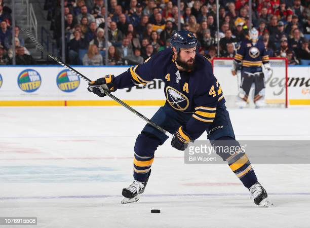 Zach Bogosian of the Buffalo Sabres looks to shoot against the Florida Panthers during an NHL game on January 3 2019 at KeyBank Center in Buffalo New...