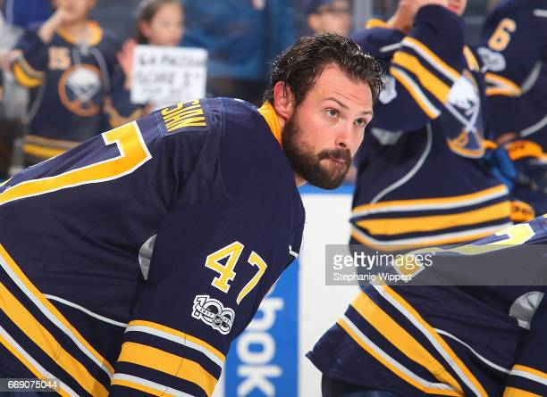 Zach Bogosian of the Buffalo Sabres of the Buffalo Sabres warms up before an NHL game against the Toronto Maple Leafs at the KeyBank Center on April...