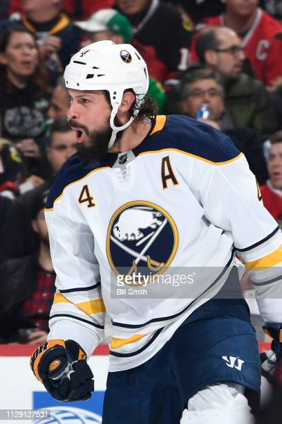 Zach Bogosian of the Buffalo Sabres reacts after scoring against the Chicago Blackhawks in the second period at the United Center on March 7 2019 in...
