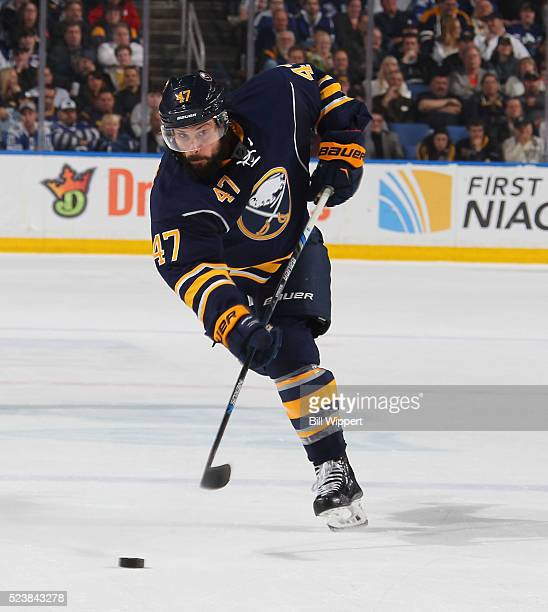Zach Bogosian of the Buffalo Sabres shoots the puck against the Toronto Maple Leafs during an NHL game on March 31 2016 at the First Niagara Center...