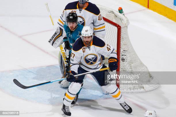 Zach Bogosian of the Buffalo Sabres skates against Mikkel Boedker of the San Jose Sharks at SAP Center on March 14 2017 in San Jose California