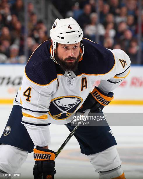 Zach Bogosian of the Buffalo Sabres skates against the Carolina Hurricanes during an NHL game on February 7 2019 at KeyBank Center in Buffalo New York