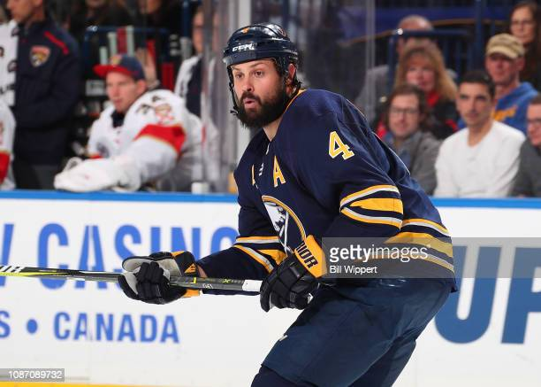 Zach Bogosian of the Buffalo Sabres skates against the Florida Panthers during an NHL game on December 18 2018 at KeyBank Center in Buffalo New York