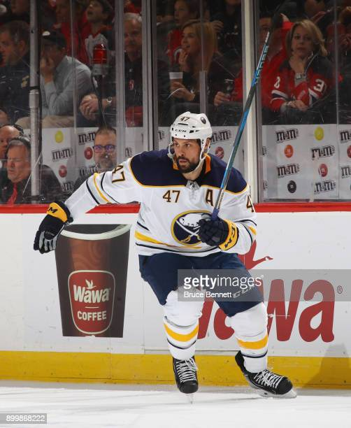 Zach Bogosian of the Buffalo Sabres skates against the New Jersey Devils at the Prudential Center on December 29 2017 in Newark New Jersey The Sabres...