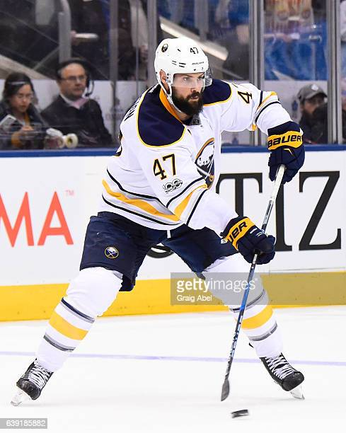 Zach Bogosian of the Buffalo Sabres skates against the Toronto Maple Leafs during the second period at the Air Canada Centre on January 17 2017 in...