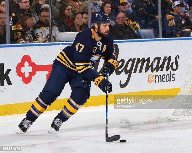 Zach Bogosian of the Buffalo Sabres skates during an NHL game against the Boston Bruins on December 19 2017 at KeyBank Center in Buffalo New York