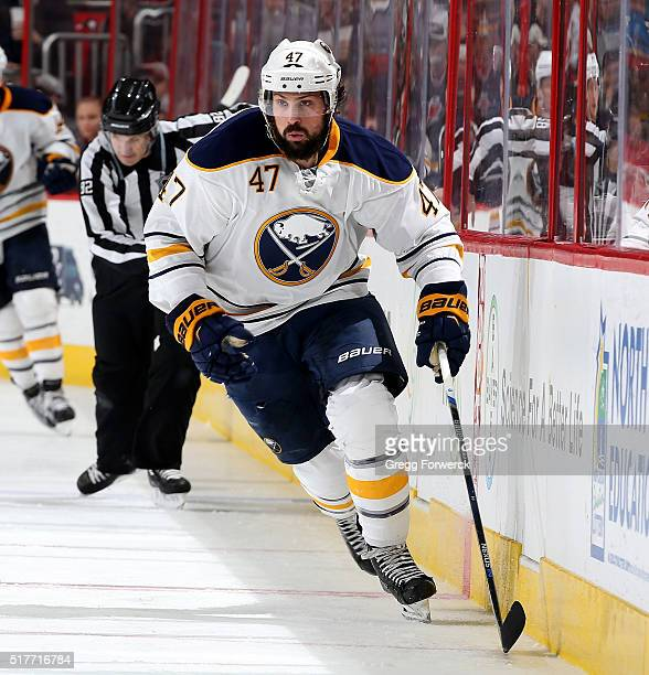 Zach Bogosian of the Buffalo Sabres skates for position along the boards during an NHL game against the Carolina Hurricanes at PNC Arena on March 22...