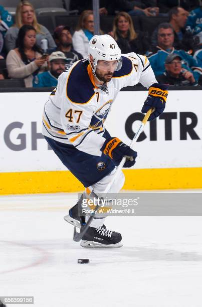 Zach Bogosian of the Buffalo Sabres skates with the puck against the San Jose Sharks at SAP Center on March 14 2017 in San Jose California