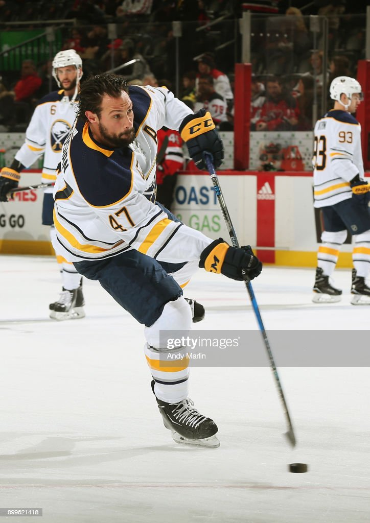 Zach Bogosian #47 of the Buffalo Sabres takes a shot during warmups prior to the game against the New Jersey Devils at Prudential Center on December 29, 2017 in Newark, New Jersey.