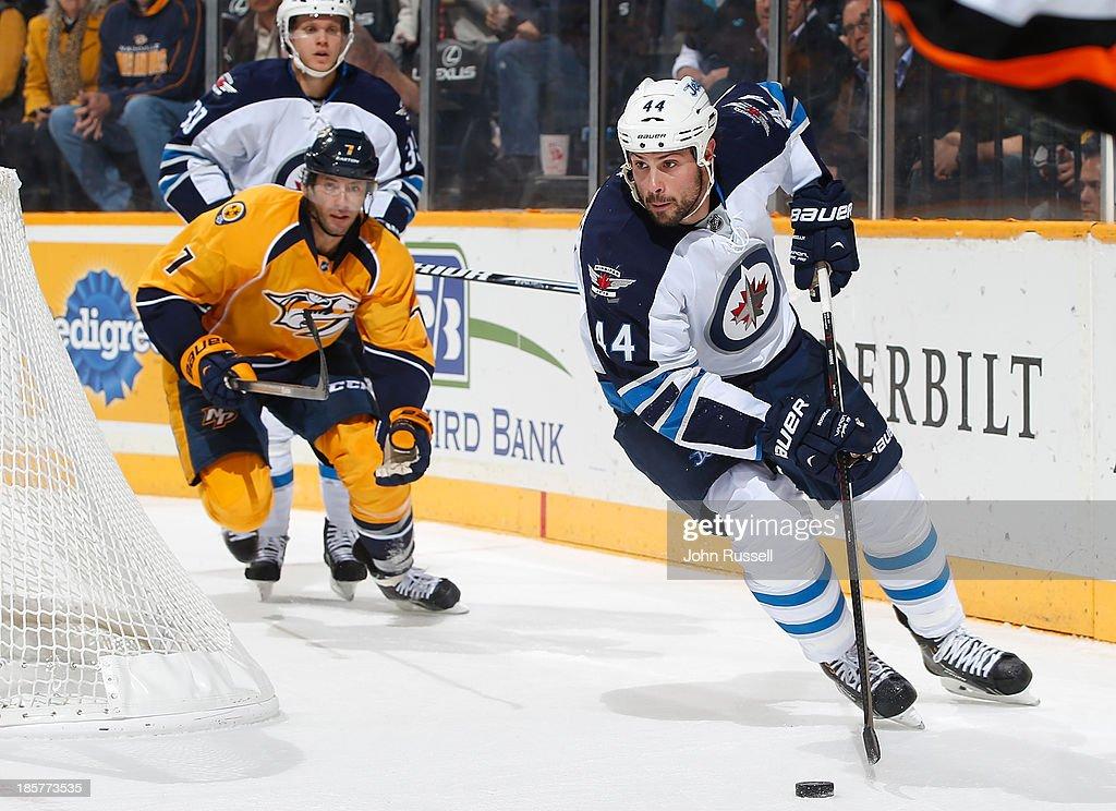 Zach Bogosian #44 of the Winnipeg Jets skates against Matt Cullen #7 of the Nashville Predators at Bridgestone Arena on October 24, 2013 in Nashville, Tennessee.