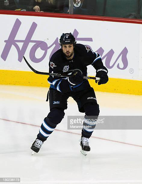 Zach Bogosian of the Winnipeg Jets skates on the ice in a game against the Carolina Hurricanes in NHL action at the MTS Centre on October 22 2011 in...