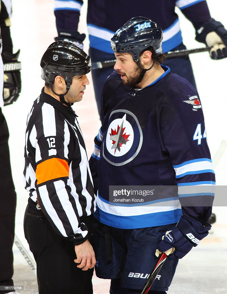Zach Bogosian #44 of the Winnipeg Jets talks to referee Justin St. Pierre #12 during a first period stoppage in play against the Pittsburgh Penguins at the MTS Centre on February 15, 2013 in Winnipeg, Manitoba, Canada.