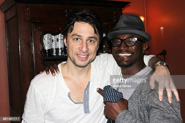 Zach Braff and Taye Diggs pose backstage at the new musical 'Bullets Over Broadway' on Broadway at The St James Theater on March 29 2014 in New York...