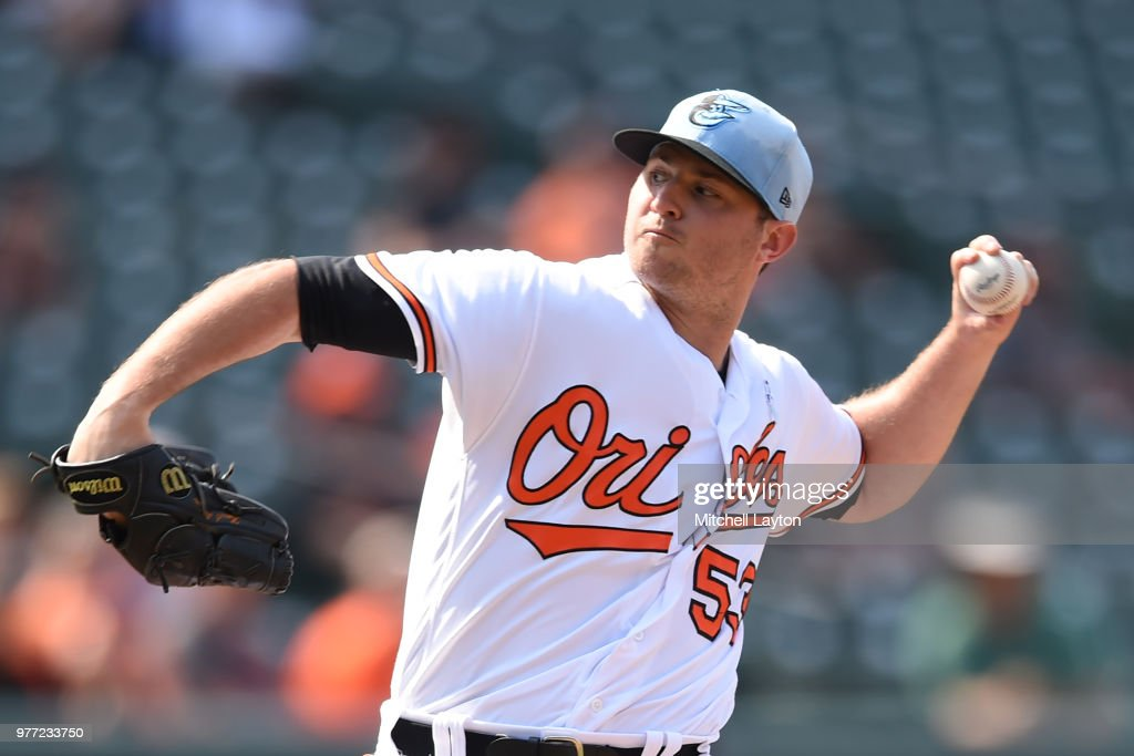 Zach Britton #53 of the Baltimore Orioles pitches in the ninth inning during a baseball game against the Miami Marlins at Oriole Park at Camden Yards on June 17, 2018 in Baltimore, Maryland.