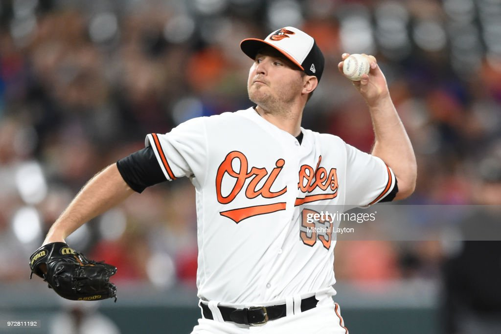 Zach Britton #53 of the Baltimore Orioles pitches in the seventh inning during a baseball game against the Boston Red Sox at Oriole Park at Camden Yards on June 12, 2018 in Baltimore, Maryland.