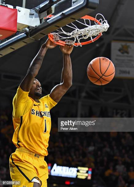 Zach Brown of the Wichita State Shockers scores with a dunk against the UCF Knights during the first half on January 25 2018 at Charles Koch Arena in...