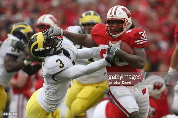 Zach Brown of the Wisconsin Badgers carries the ball during the game against the Michigan Wolverines at Camp Randall Stadium on November 10 2007 in...