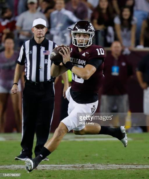 Zach Calzada of the Texas A&M Aggies runs with the ball as he looks for a receiver against the Alabama Crimson Tide at Kyle Field on October 09, 2021...
