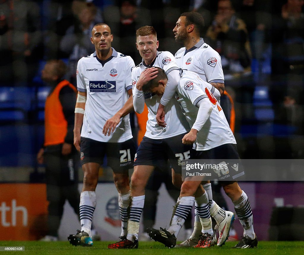 Zach Clough (R) of Bolton celebrates his goal with team mate Josh Vela (C) during the FA Cup Third Round match between Bolton Wanderers and Wigan Athletic at the Macron Stadium on January 3, 2015 in Bolton, England.