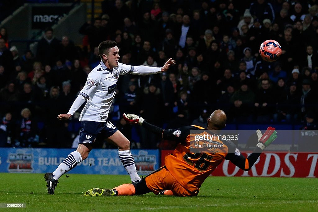 Zach Clough (L) of Bolton scores the opening goal during the FA Cup Third Round match between Bolton Wanderers and Wigan Athletic at the Macron Stadium on January 3, 2015 in Bolton, England.