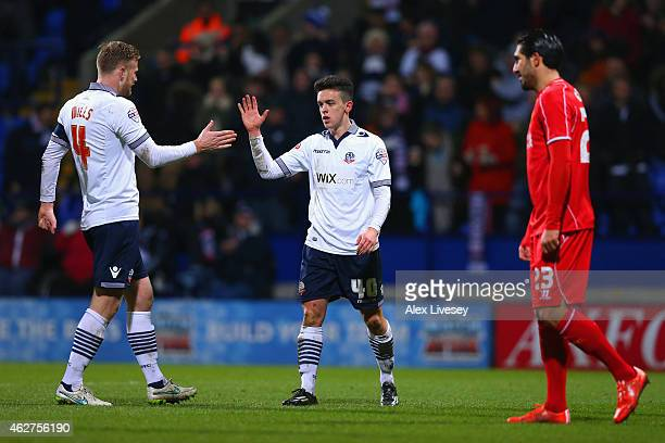 Zach Clough of Bolton Wanderers celebrates with Matt Mills of Bolton Wanderers after being awarded a penalty after a foul by Martin Skrtel of...
