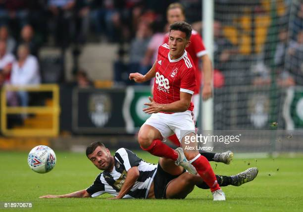 Zach Clough of Nottingham Forest beats a challenge during a preseason friendly match between Notts County and Nottingham Forest at Meadow Lane on...