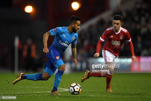 Zach Clough of Nottingham Forest chases Theo Walcott of Arsenal during The Emirates FA Cup Third Round match between Nottingham Forest and Arsenal at...