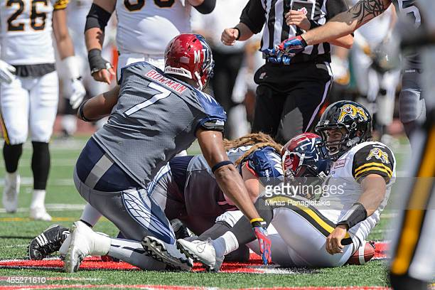 Zach Collaros of the Hamilton TigerCats looks at John Bowman of the Montreal Alouettes after being sacked during the CFL game at Percival Molson...