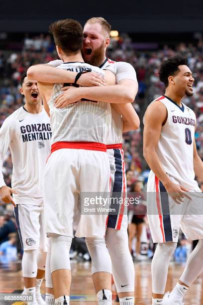 Zach Collins and Przemek Karnowski of the Gonzaga Bulldogs react after the game during the 2017 NCAA Men's Final Four Semifinal against the South...