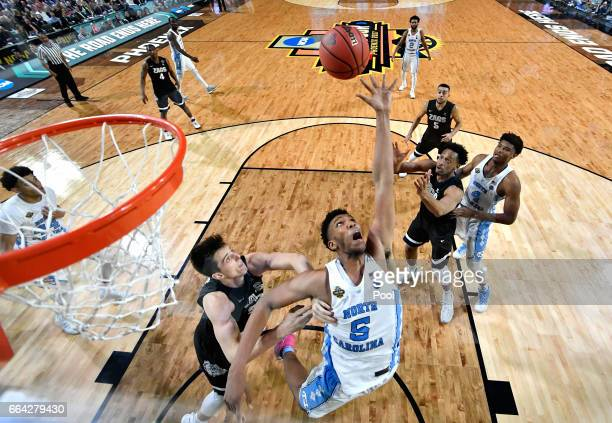 Zach Collins of the Gonzaga Bulldogs and Tony Bradley of the North Carolina Tar Heels compete for a rebound during the 2017 NCAA Men's Final Four...