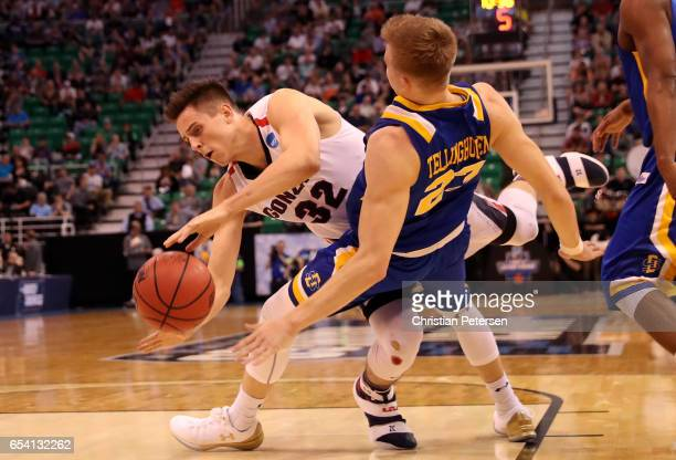 Zach Collins of the Gonzaga Bulldogs collides with Reed Tellinghuisen of the South Dakota State Jackrabbits in the first half during the first round...