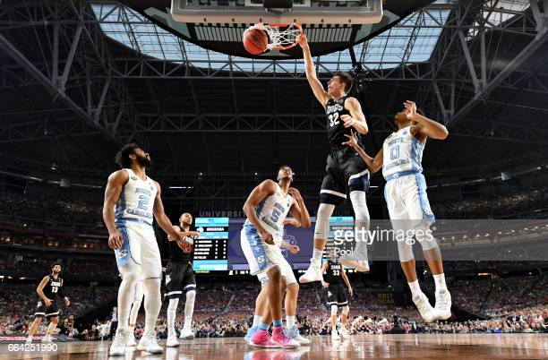 Zach Collins of the Gonzaga Bulldogs dunks in the first half against Nate Britt of the North Carolina Tar Heels during the 2017 NCAA Men's Final Four...