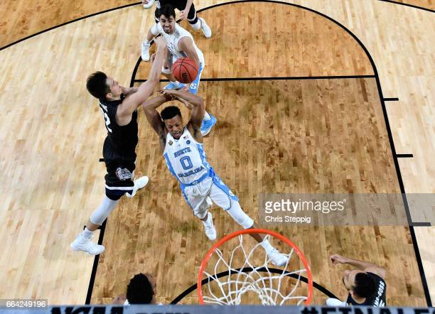 Zach Collins of the Gonzaga Bulldogs gets a block on Nate Britt of the North Carolina Tar Heels during the 2017 NCAA Men's Final Four National...